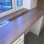 Одним из наиболее модных трендов в дизайне интерьеров считается использование кухонных столешниц, совмещенных с подоконником.
