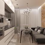Кухня - гостиная с кирпичной стеной.