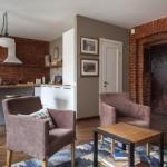 Лофт гармонично объединит техническую зону кухни с общим пространством гостиной.