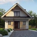 Красивый компактный дом с мансардой.